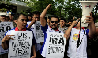 "Protestors outside the UK Embassy in Jakarta with ""We welcome IRA"" slogans"