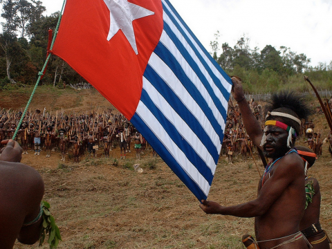 A daring flag raising ceremony in the central highlands of West Papua.
