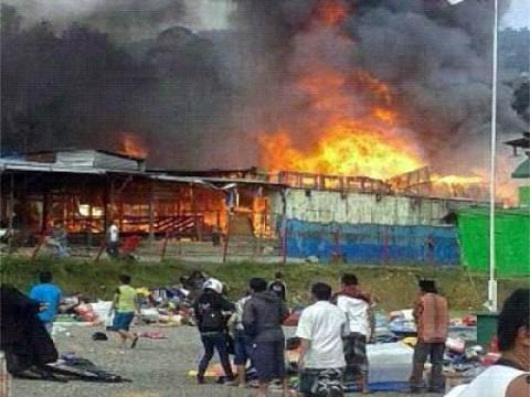 Stalls in flames in Karubuga, 17 July